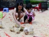 Cute girls playing with duckling at Petting Zoo section-min