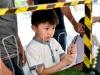 Kids focusing on wire loop game-min