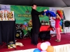 Magician performing magic show with audience.-min